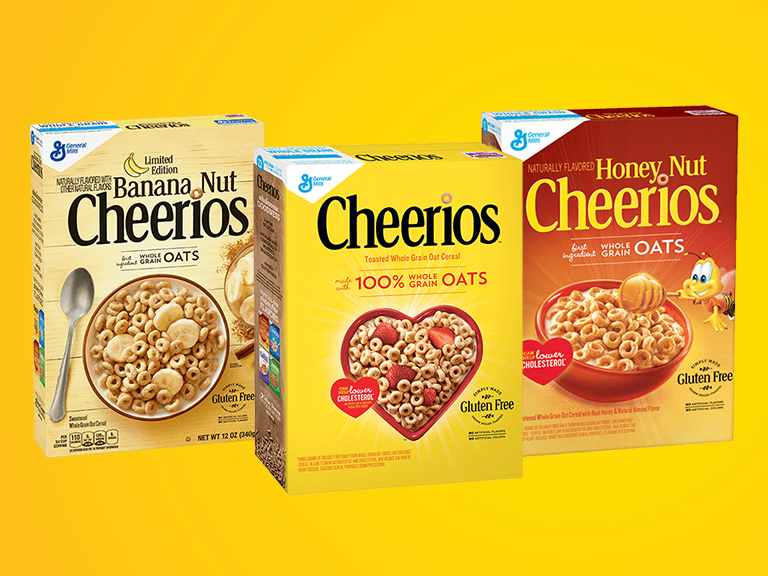 Assorted boxes of Cheerios on yellow background