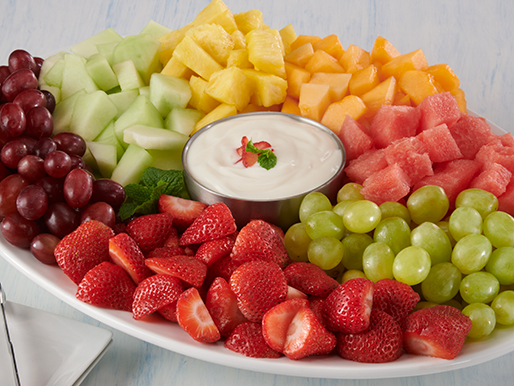 platter with fresh cut fruit and yogurt dip