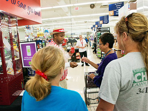 Grover Family Fare customers line up to enter to win prizes.