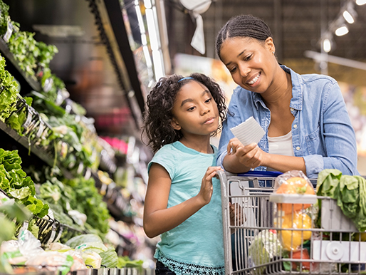 Mother Daughter reading label in produce section