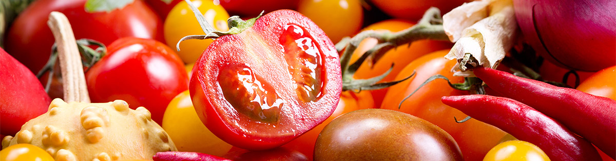 a-colorful-cherry-tomato-cut-in-half-on-other-vegetables