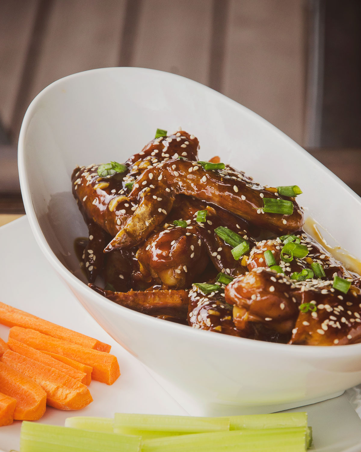 The finished Teriyaki Wings recipe is now garnished and ready to be enjoyed.